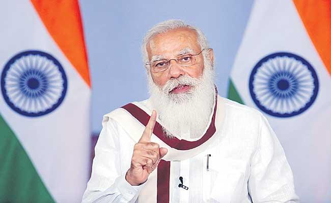 PM Narendra Modi undertakes comprehensive review of Covid-19 - Sakshi