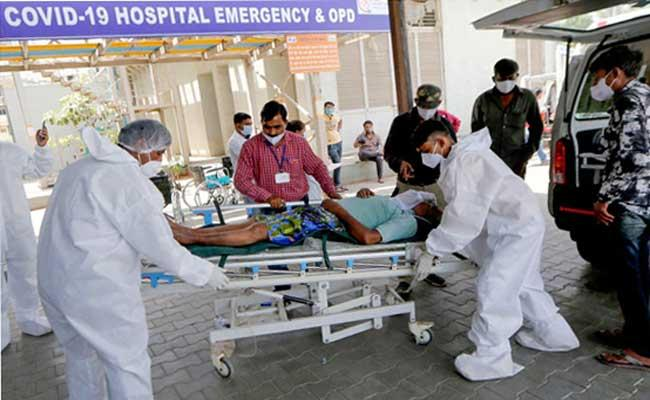 India reports 4,12,262 new Covid-19 cases, 3,980 deaths in 24 hours - Sakshi