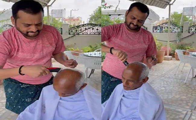 Bandla Ganesh Turns As Barber For His Father Video Goes Viral - Sakshi