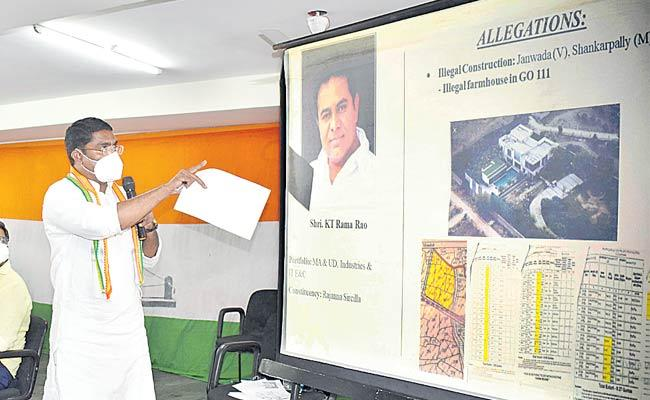 Congress Sampath Kumar powerpoint Presentation On Illegal Land - Sakshi