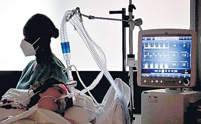 Positive Covid test report not mandatory for hospitalisation - Sakshi