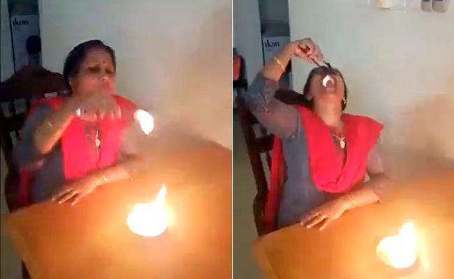 Woman Swallows Fire Balls Netizens Link Video Corona Cure Viral - Sakshi