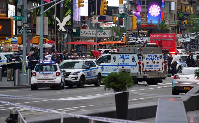 Gun And Open Fire In America Times Square - Sakshi