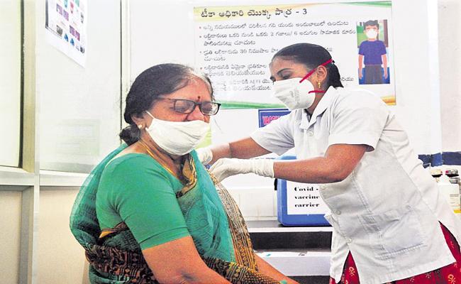 Aadhaar is not mandatory to get the corona vaccine says AP Govt To High Court - Sakshi
