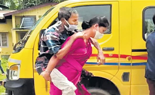 Assam Niharika Das carries Covid-infected father-in-law on back - Sakshi