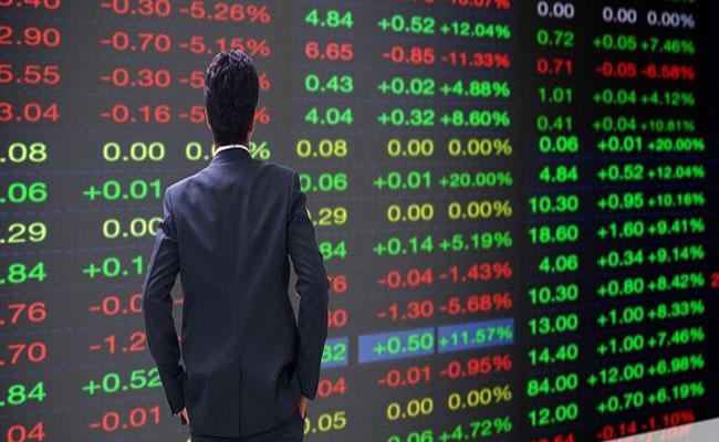 Indices log record highs, Nifty tops 15850 - Sakshi