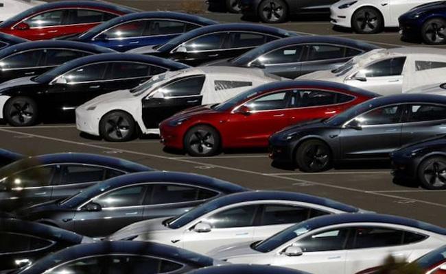 American Electric Vehicle Maker Tesla Begins Testing Model 3 In India - Sakshi