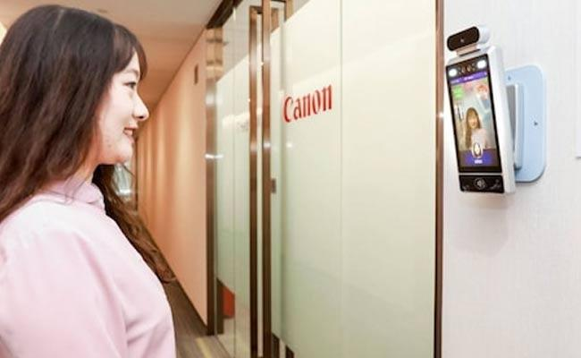 Canon Smile Recognition AI Only Lets Smiling Employees Allowed Into Offices - Sakshi