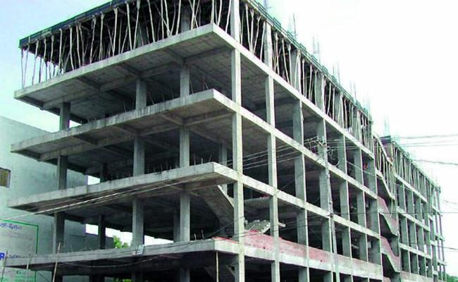 lllegal Constructions in Government Places In Mancherial - Sakshi