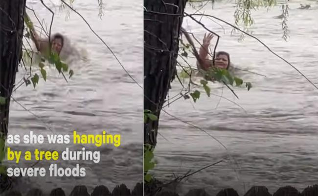 Woman Stuck In Flood Water Rescued After - Sakshi