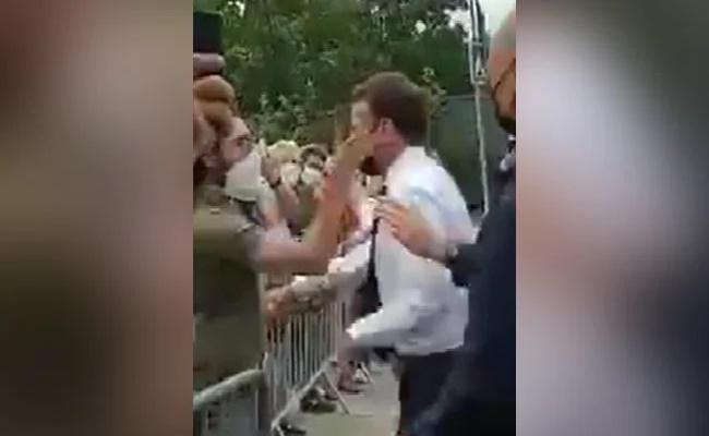 France President Emmanuel Macron Slapped By Man He Tried To Shake Hands - Sakshi