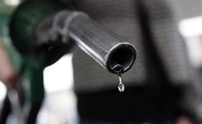 Woman Petrol Attack On MRO in Jagtial - Sakshi