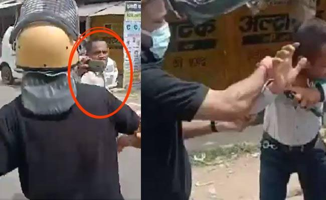 UP IAS Officer Thrashes Journalist In Public During Local Polls Viral - Sakshi