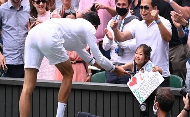 Novak Djokovic Gives His Racquet To A Young Fan After Wimbledon Win Video Viral - Sakshi