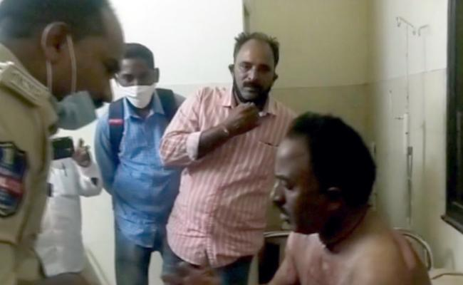 Sarpanch Attack On NREGA Technical Assistant With Petrol In Nirmal - Sakshi