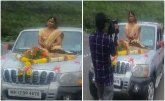 Viral: Bride Rides to Wedding Venue on Bonnet of Moving SUV, What next - Sakshi
