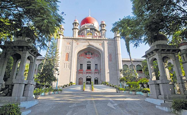 High Court clarified interim orders could not be issued suspending auction govt lands - Sakshi