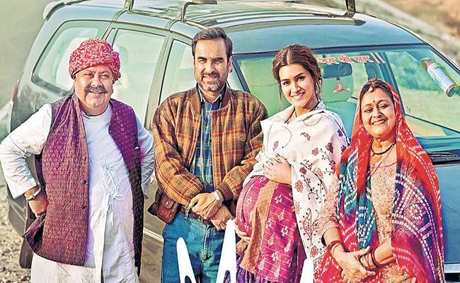 Kriti Sanon and Pankaj Tripathi film mixes up surrogacy - Sakshi