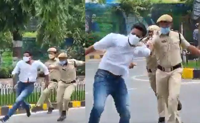Revanth Reddy Fires On Police Over Chalo Raj Bhavan Against Fuel Price - Sakshi