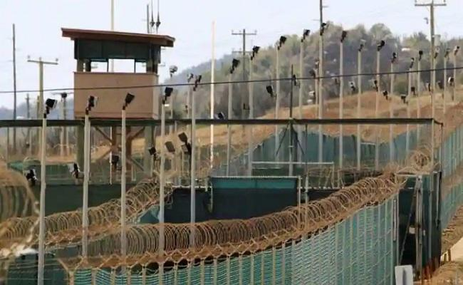 US transfers the first detainee out of Guantanamo - Sakshi