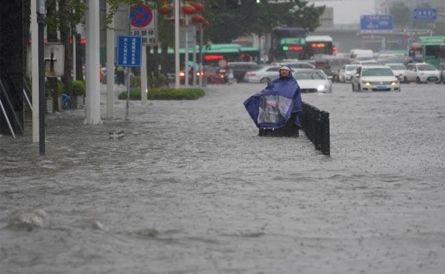 Heavy Rainfall Floods Streets And Subway Stations In China - Sakshi