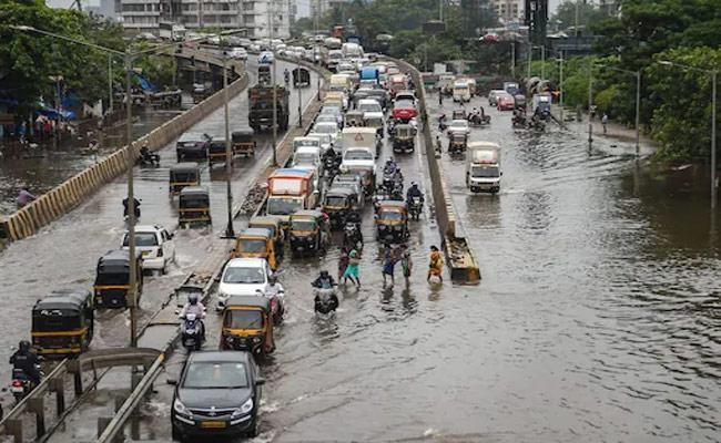 Heavy Rain Fall In Mumbai  - Sakshi