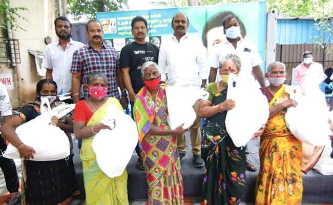 Film Producer Ravindran Distributed Groceries To Poor Families - Sakshi