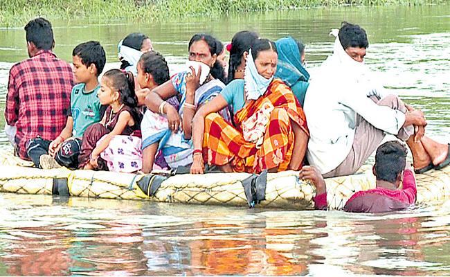 Komaram Bheem People Struggle With Rains Disrupt Road Connectivity - Sakshi