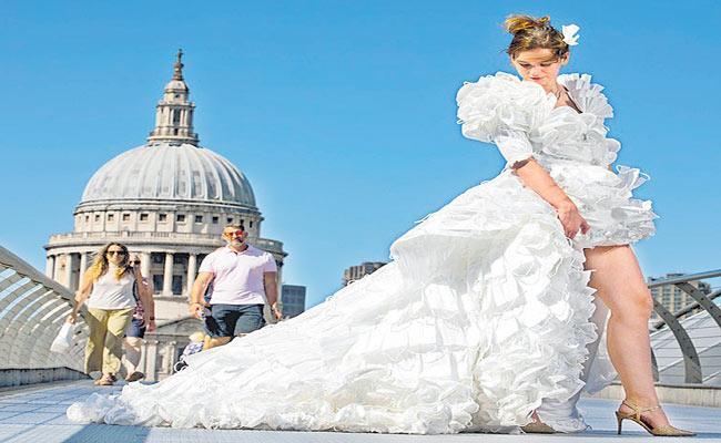 Wedding dress made entirely of face masks In UK - Sakshi