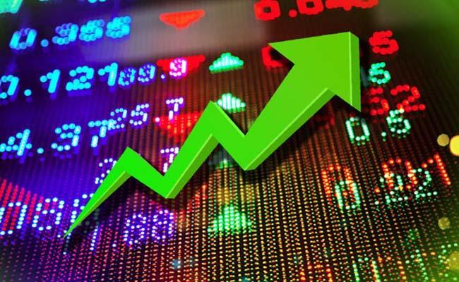 Sensex Soars Over 405 Points, Nifty Above 15,700  - Sakshi