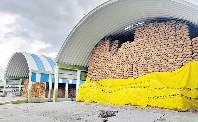 Telangana: Warehouse Filled With Rice Stocks - Sakshi