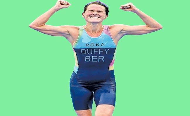 Bermuda's Flora Duffy Wins Gold In Women's Triathlon Race Of Champions - Sakshi