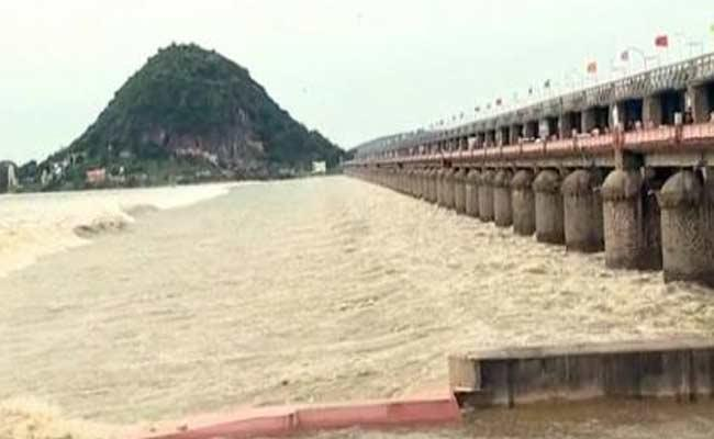 Officials Alerted To Possibility Of Heavy Flood Water Reaching Prakasam Barrage - Sakshi