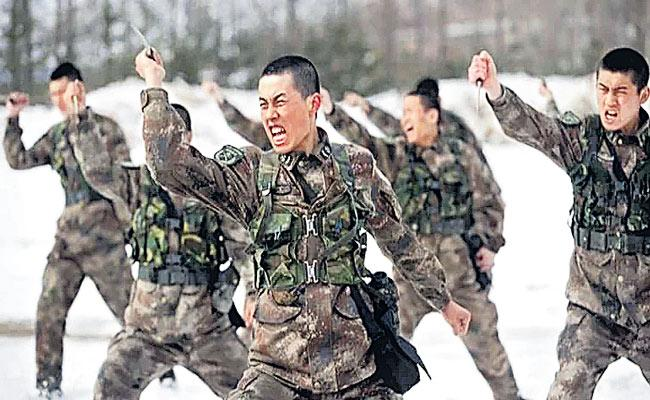 China recruiting Tibetans in PLA for deployment at LAC - Sakshi