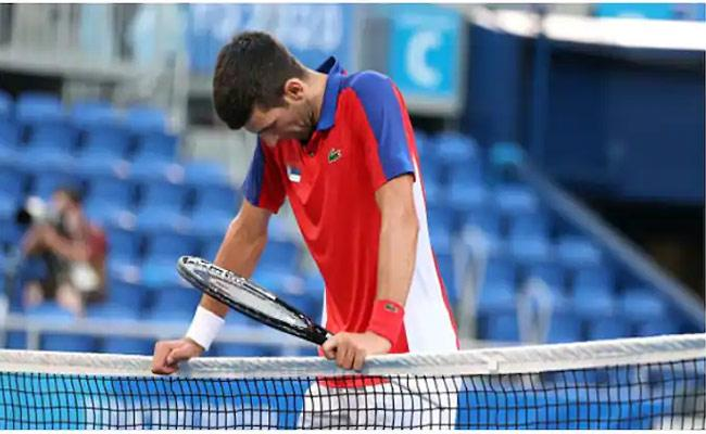 Novak Djokovic Lost Bronze Medal Match Against Carreno Busta - Sakshi