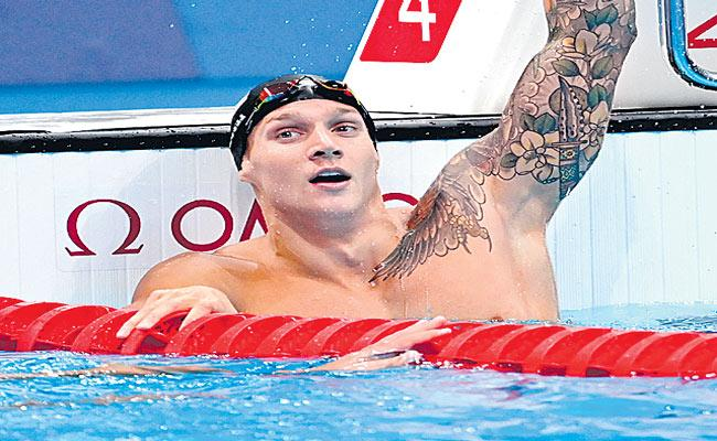 Caleb Dressel Shatters World Record to Win 100m Butterfly Gold - Sakshi