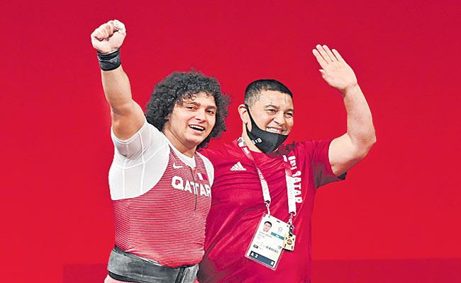 Weightlifter Meso wins Qatar first ever Olympic gold medal - Sakshi