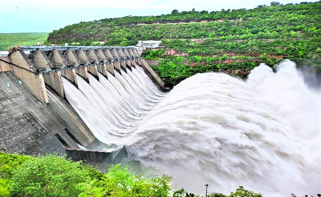 Huge Flood water Flow In Krishna River - Sakshi