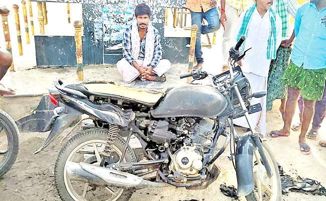 Young Man Burns His New Bike Protest Of Petrol Prices Hike Mahabubnagar - Sakshi