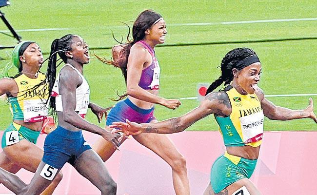 Tokyo Olympics: Elaine Thompson New History Double Double Gold - Sakshi