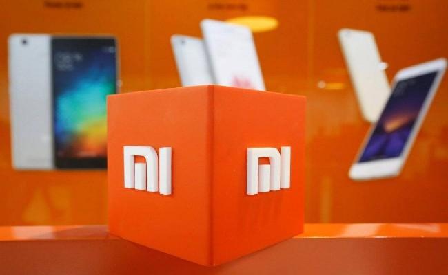Xiaomi Drops Mi logo on premium products in India - Sakshi
