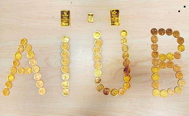Shamshabad Airport Police Found Gold Biscuits And Chocolates - Sakshi