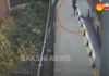 Boy narrowly escapes being run over by bus after tripping over guard rails - Sakshi