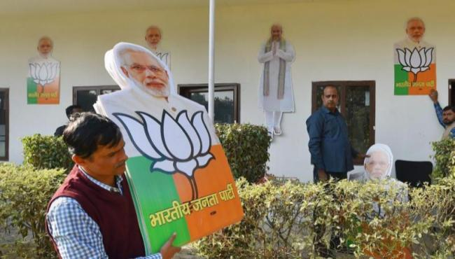 BJP loses Modi's hometown to Congress - Sakshi
